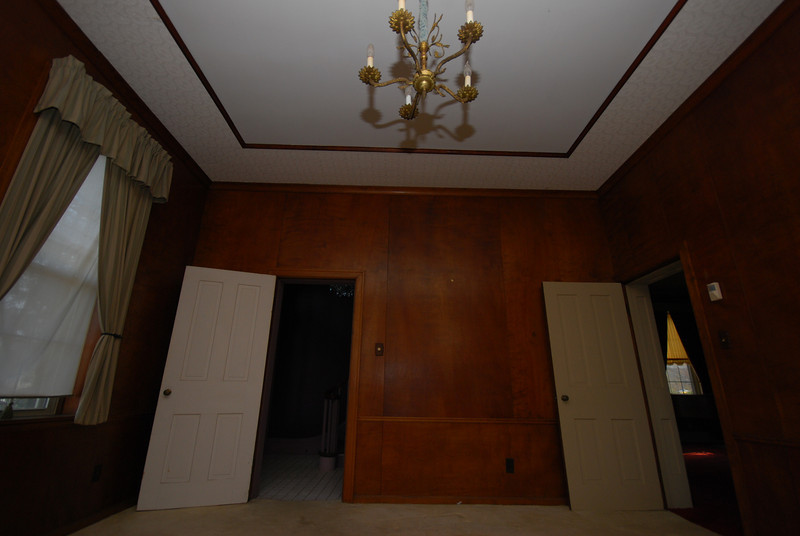 The door on the left leads to the foyer. The door on the right leads to the living room.