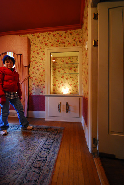 The built-in display case in the dining room has a light! (This is a great pose from Mom.)