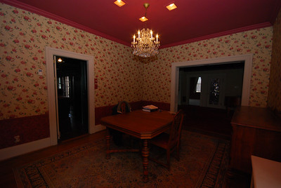 The dining room leads to the kitchen on the left and to the living room, TV room, and foyer on the right.