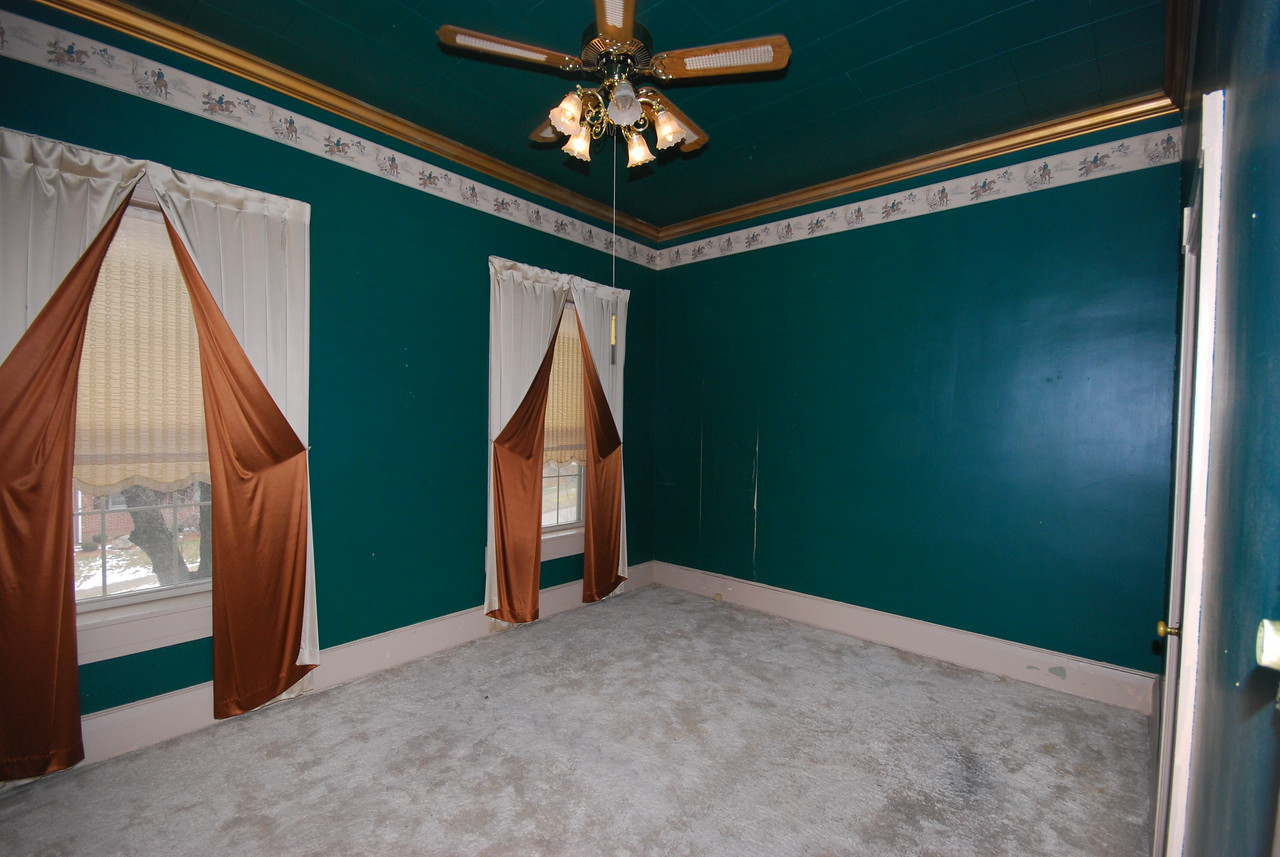 "The green bedroom. Mom called the window treatments ""Dracula Drapes."""
