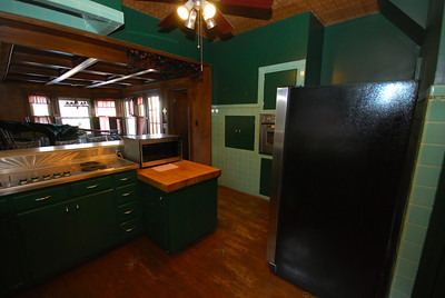Here you can see the faux-tin ceiling. The dumbwaiter door is left of the oven.