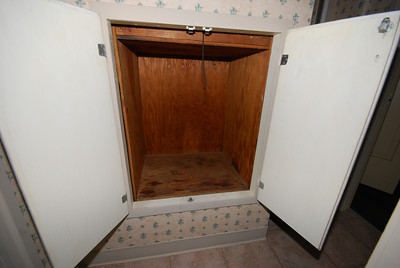 Here's the dumbwaiter carriage at the second floor.  I'm sitting on the toilet to take this shot.