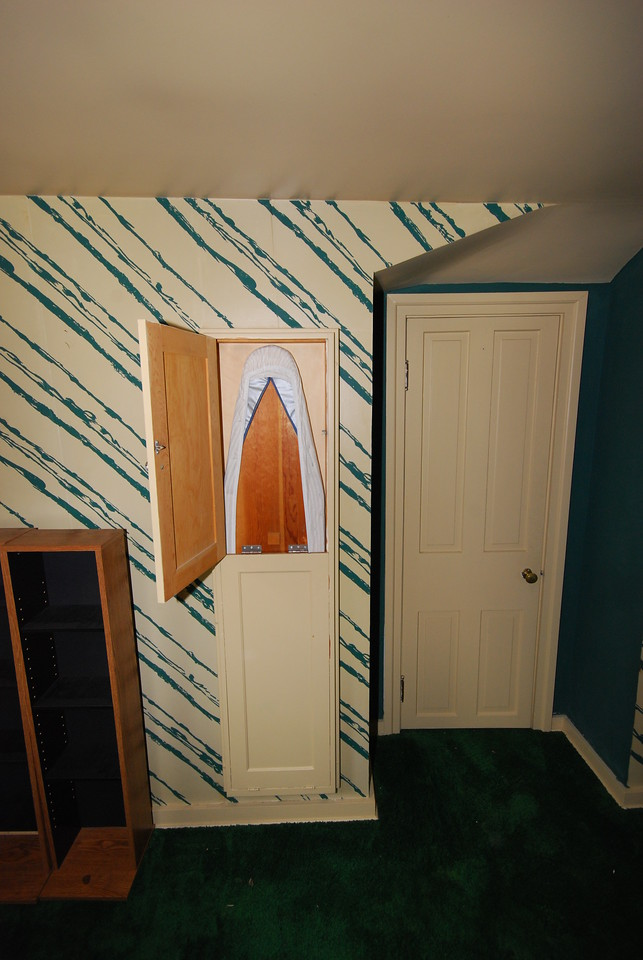 Ironing board for the maid. The door at right leads into the cold room.