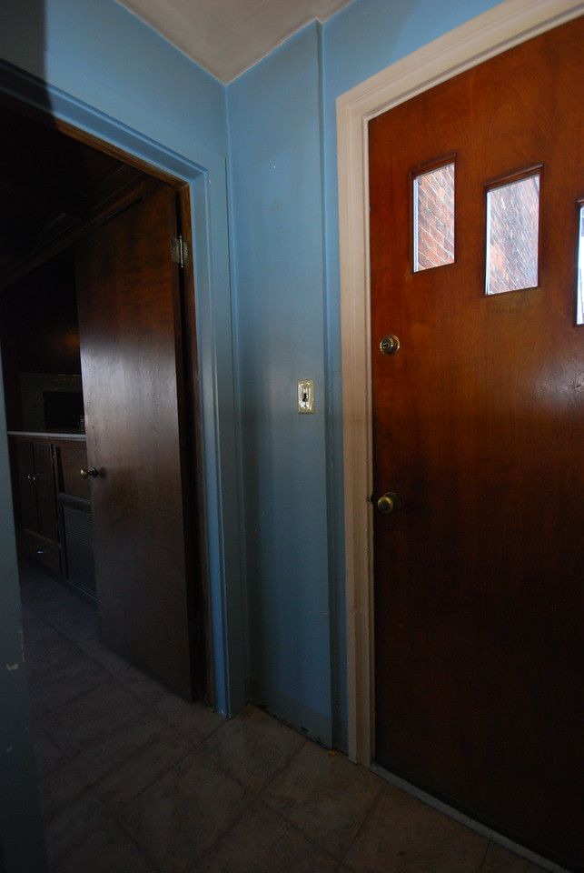 This is the side/back entrance. You step in through the open door to the breakfast nook with the kitchen to the right.