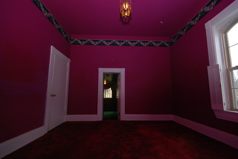 The red bedroom is the only upstairs linkage between the maid's area (ahead and down) and the remainder of the house.