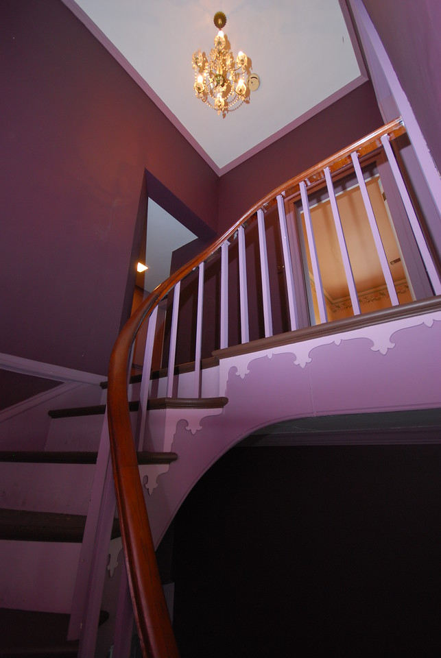 We're getting a peek of the master bedroom at the top of the stairs.