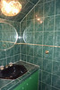 Downstairs bathroom under stairs. Even the ceiling has green tile...