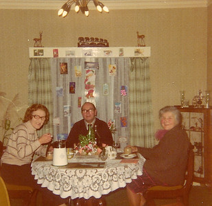 DPB-167: May (Maisie) Barr nee McKeown, David Barr Snr and Lizzie McKeown at Christmas at 187