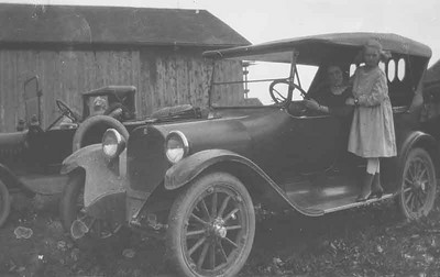 This is Great grandpas Car and Hazel is in the drivers seat and her sister Gladys is standing on the running board.