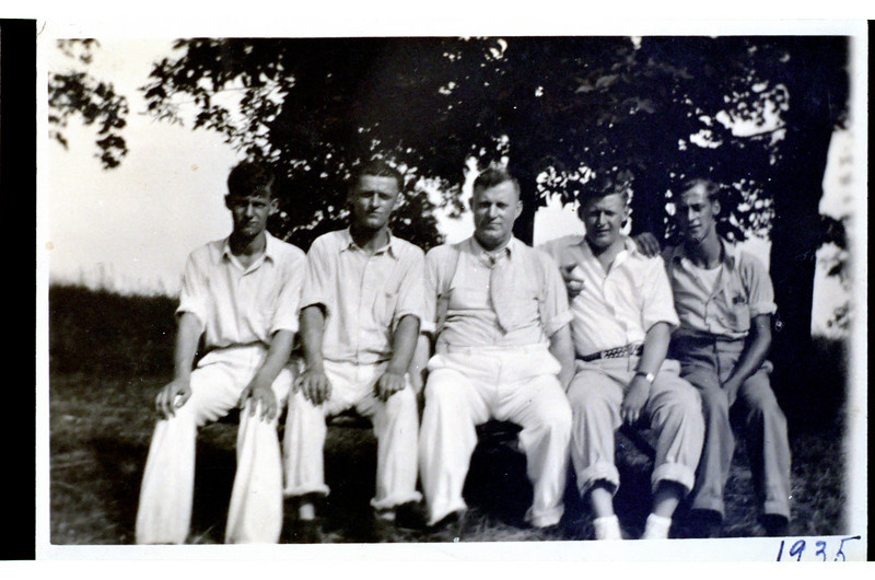 "George Strelka is 4th from left--father in middle, surrounded by 4 sons.  Scan performed 4 April 2004 of color negative (Kodak Gold 100-2 5095, 2 exposures) taken from print labeled ""1935"".  Negative was porbably taken in 1980s, perhaps early 1990s.  Receipt is labeled ""12/29"" (no year).  Original exposure is 3 3/4"" x 2 1/2"" on paper measuring 4 1/4"" x 2 3/4"".  Original photo and 5x7 print from negative are in ""One Hour MotoPhoto"" envelope."
