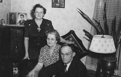 Taken in the living room of our apartment on ninth st. in jamestown. My mother in the middle and my Aunt and Uncle Frankie and judd Greenfield.