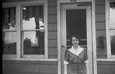 There is a star in the window showing that someones son or daughter was serving in the war but I am not sure where this picture of my Mom was taken.