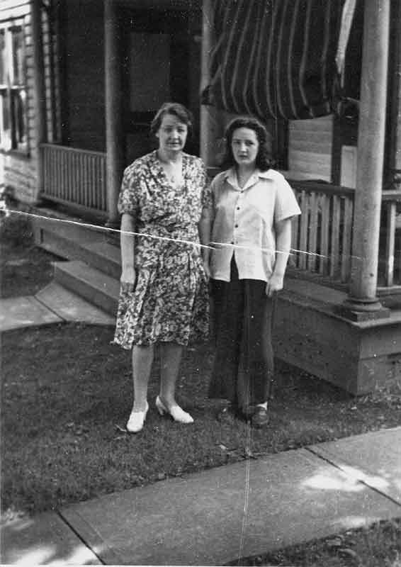 Awful but I put it up anyway. my mom and i in front of our apartment.