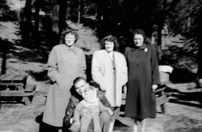 I am not sure where we are but there seem to be picnic tables in the back ground. This is Janet, Pat Hazel elwin and linda but it is not very clear.