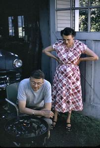 Grandma and grandma fixing hamburgers on the grill. Grandmas hamburgers were very very good!