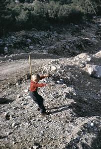 Gary throwing rocks at Crystal lake camp site.