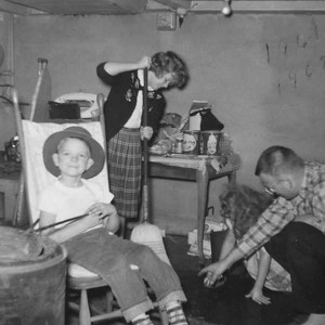 This was in the celler of Grandpa Edbergs house. I don't know what Kathy was doing but Gary was enjoying the rocking chair and the heat from the furnace. It may have been the christmas of 1961.