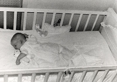 another picture of John asleep in his crib.