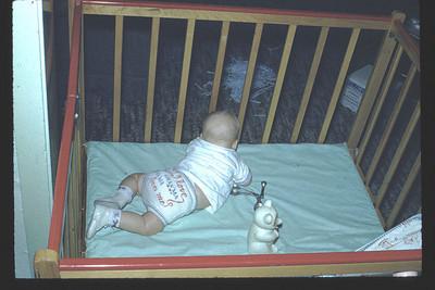 19600701_baby_john_in_crib_.jpg