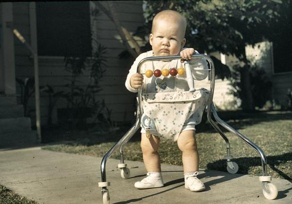 John in walker in front of house--under fed.