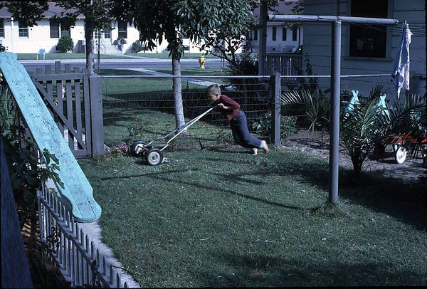 Gary mowing the lawn. (e.g. how to keep your kid in good physical condition)