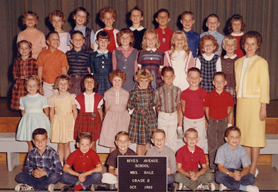 This picture is dated 1963 on the plaque in front of the class but John is in the top roe and he would only been three years old in 1963.