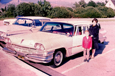 Mom and John standing outside the Plymouth station wagon