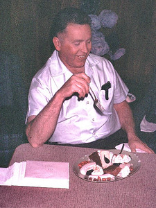Dr. Carl Tague at Nash's house for progressive dinner. He was eating his birthday cake. It was always his birthday.