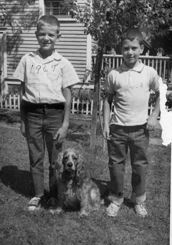 Don't know the boy but his name on the back is Tom. the dog belonged to the Johnsons that lived across from Grandma. Grandpa branded Garys chest with the date,