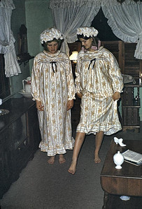 Linda and Kathy showing off in matching nightgowns.