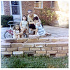 Rebuilding the patio wall, Spring 1970. Tina Gilchrist, Jenny, Dad, Bud.