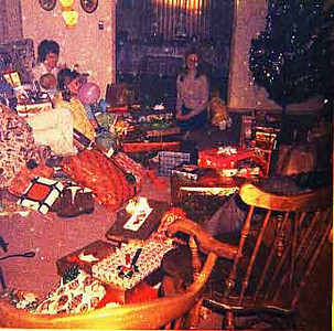 Another Christmas scene with Pat Linda and Kathy.