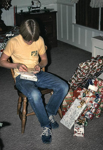 Christmas morning with John turn to open gifts.