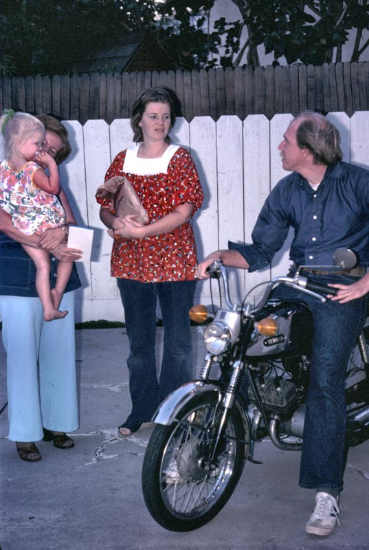 Kim in Pats arms, Kathy and Jay on motorcycle.