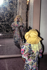 Kimmy is checking herself out in the entrance mirror. Kathy did a real good job of dressing her like a clown.