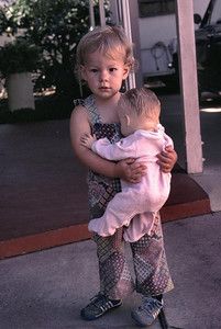 Kristina is holding Toodles that belonged to her mom when she was little.