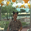Eugene posing with his Mickie Mouse ears at The Plaza Restaurant in the Magic Kingdom