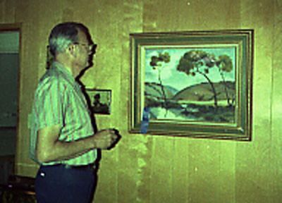 Ed looking at the painting that I won Best of Show for.