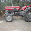 1974 Massey Ferguson 135 with front mount snow plow.