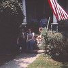 Will, Jeff, Linda, Dolly on steps. Dad & Mom on porch.