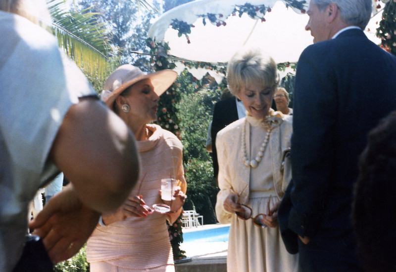 """Mom & Dad at a """"Renewal of Vows"""" ceremony for Joe Bologna and Renee Taylor in Beverly Hills, CA, early '80s.  Joan Collins in pink."""