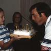 Rebecca holding Uncle Gary's Birthday Cake.  Make a wish!