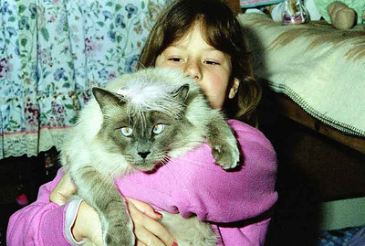 Kristina holding Samantha. the cat was a stray and had been hurt so linda fed it and she stayed there.
