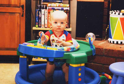 Jake in his walker which he would tolerate for a little while.