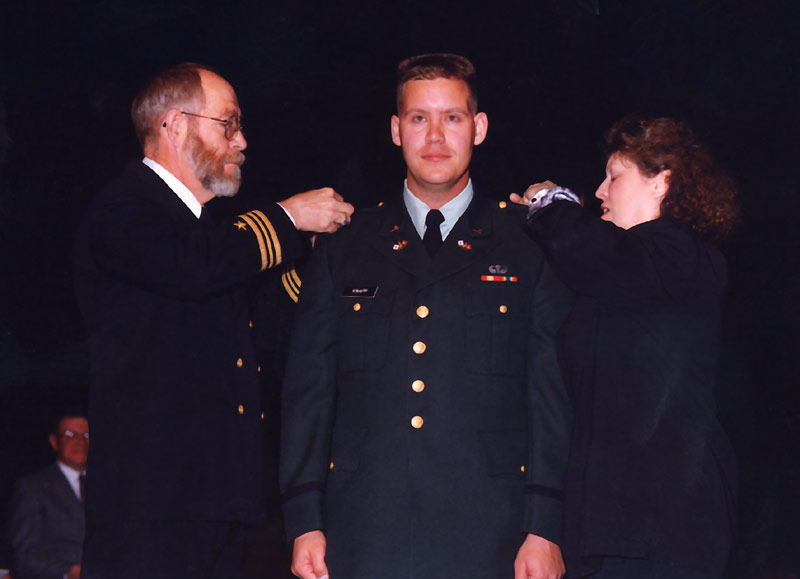My parents are pinning my second lieutenant's bars on to me, right after being sworn in.