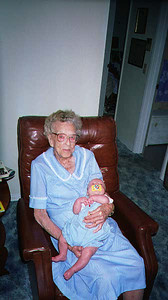 """Grandma Todd holding the """"little lump of lead"""".  James weighed 11 pounds and she loved holding him."""