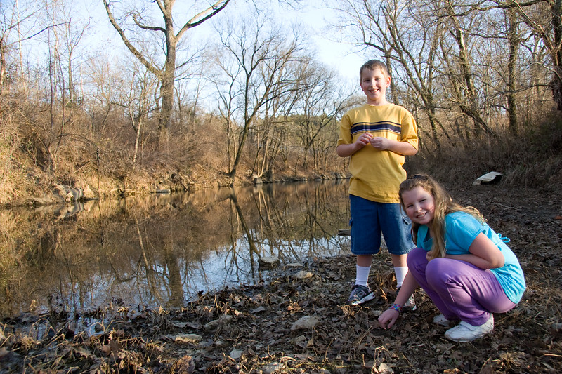 Joshua and Abigail finding clam shells by the creek.
