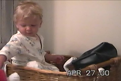 April 2000 Nick plays in sock basket, Ralph watches TV with Nnicholas
