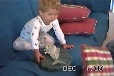 Dec 2000 Nicholas palying on the couch, wearing Moms shoes  Are you feeling lucky, Ralph howling, Brushing his teeth,watching Santa sing