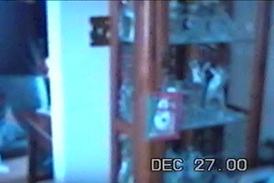 Dec 2000 Nicholas shoveling snow, rides in sled